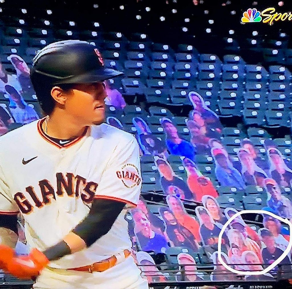 Local fans Karen Campbell and Chris Towne captured screen shots of their cardboard selves at the San Francisco Giants home opener Tuesday.
