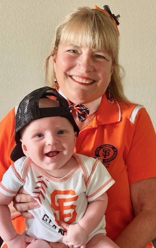 """Karen Campbell and her 4-month-old grandson Finn posed for a photo that was used to create a cardboard cutout """"seated"""" in the stands at Giants home games."""