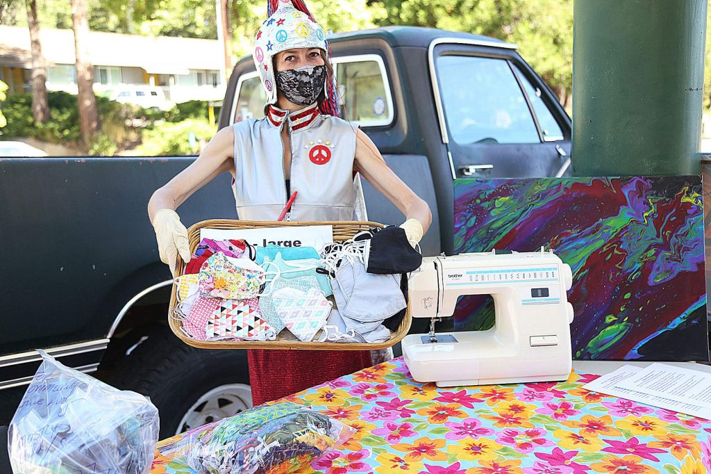 "Nevada County Masks founder Lexis LaRue dons her mask warrior outfit while taking part in Saturday's free mask giveaway. ""We've gone through all of the mom's fabric, grandma's fabric,"" LaRue said. ""For every dollar donated, we can make two masks."""