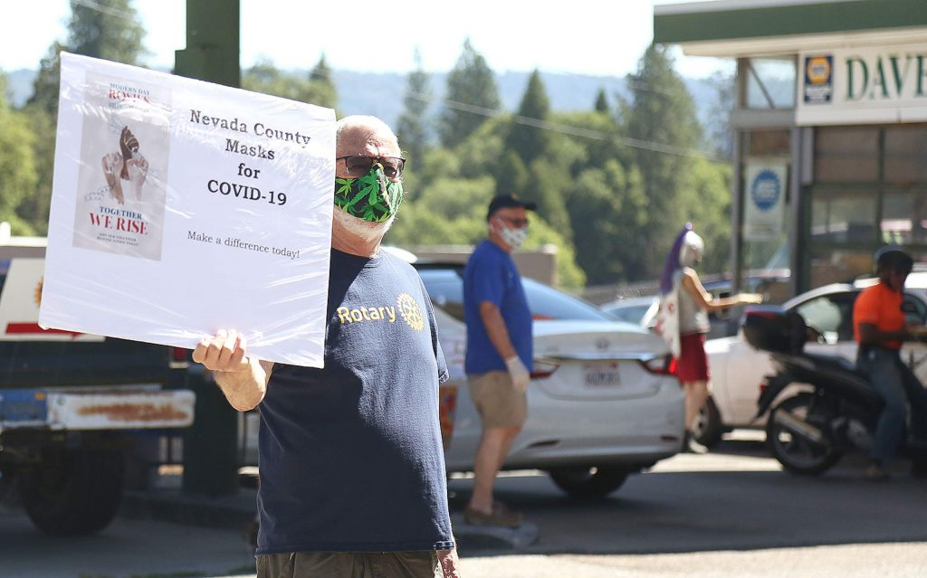 Rotary of Nevada City members were out in force Saturday morning helping to distribute free masks in front of Dave's Auto Repair in Nevada City. During the first giveaway, vehicles could be seen lined up down Zion Street to take part in the free giveaway.