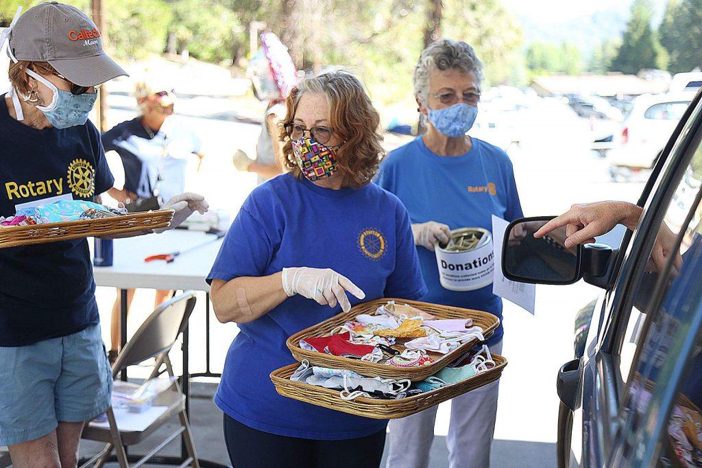 Rotarians of Nevada City were busy Saturday morning with their second round of free mask giveaways held at Dave's Auto Repair off Zion Street. The event, sponsored by Nevada County Masks and the Rotary Club of Nevada City, distributed 400 masks within minutes during their first event. Last Saturday's event had another 400 masks slated to be given away for free with donations accepted.