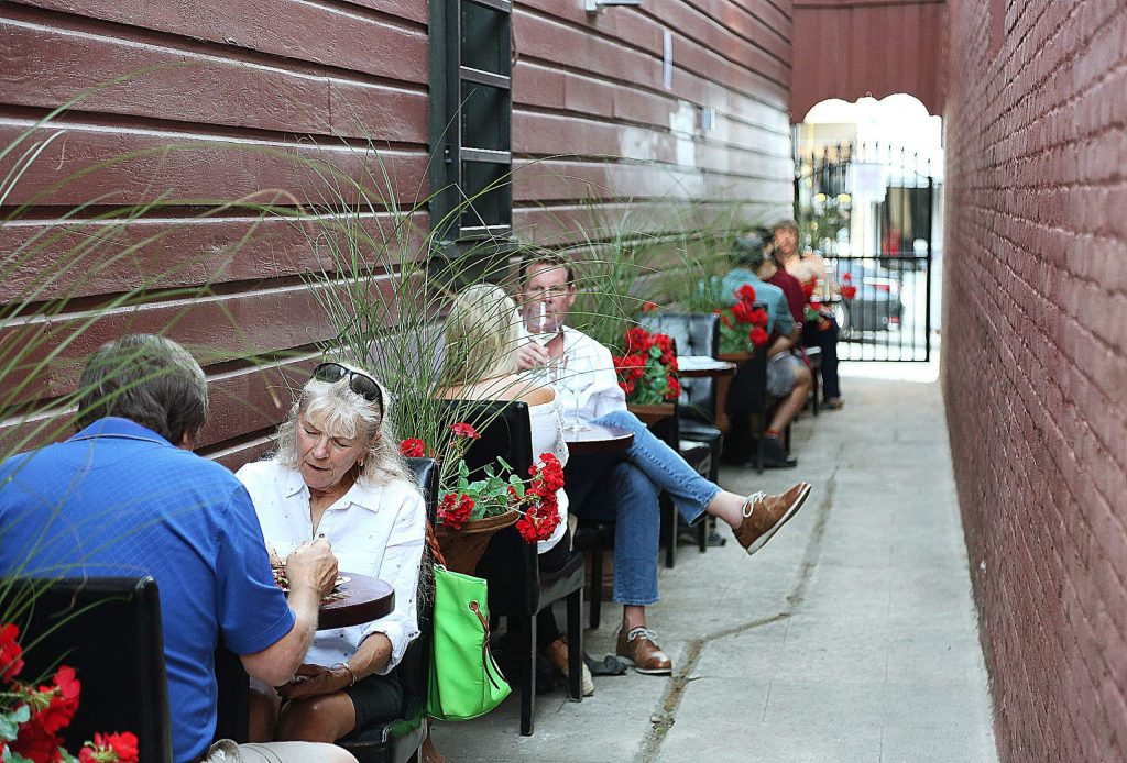 A breezeway next to the Golden Era in Nevada City is being utilized for outdoor seating.