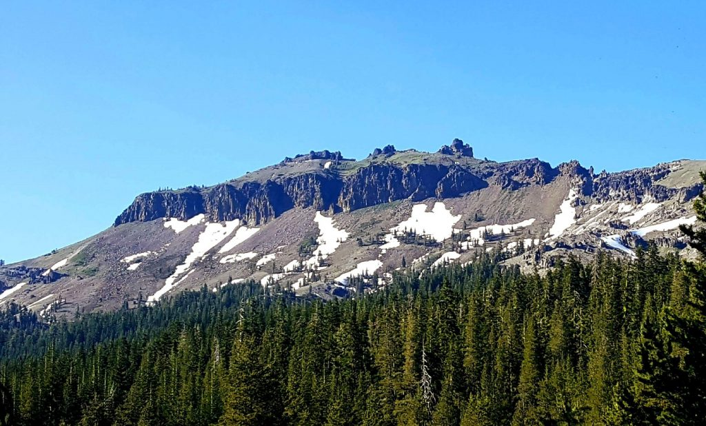 Castle Peak is names for the volcanic rock formations etched by wind, rain and snow at its peak standing like castle turrets more than nine-thousand feet above sea level.