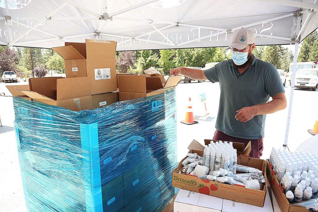 South Fork Vodka founder and master blender Jonathan Dorfman packs bags of various South Fork hand sanitizing products into bags during Tuesday's giveaway.