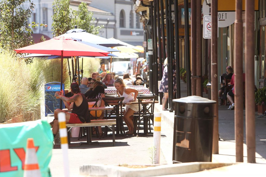 Outdoor dining customers use the benches and shaded areas in front of Old Town Cafe and Mezé Wednesday in downtown Grass Valley.