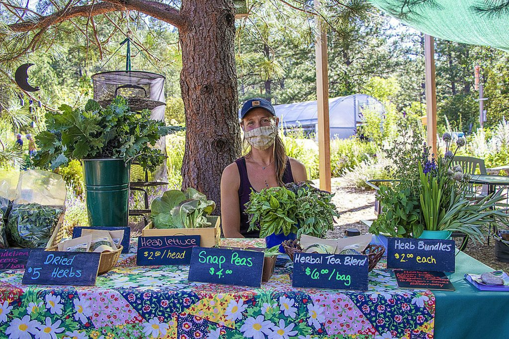 Emily from Sierra Harvest welcoming folks to the Food Love Farm Stand which is open every Tuesday night 4:30 to 6:30 pm to pick up fresh organic fruits, vegetables and flowers.