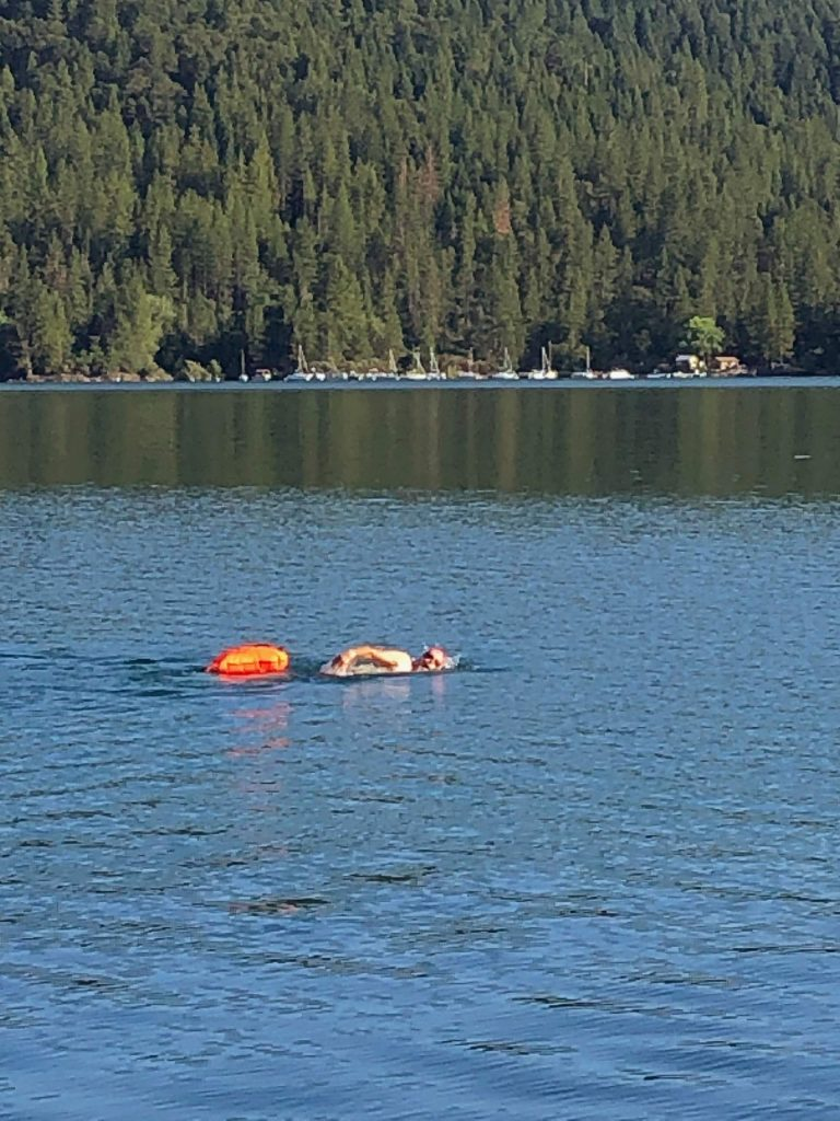 Early Saturday morning swimmer at Scott's Flat Lake, Cascade Shores.