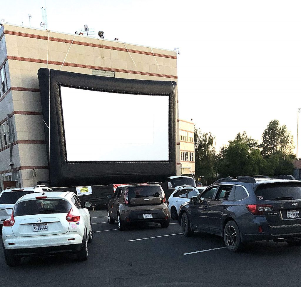 Getting ready for movie to start at Grass Valley's first drive-in theater.