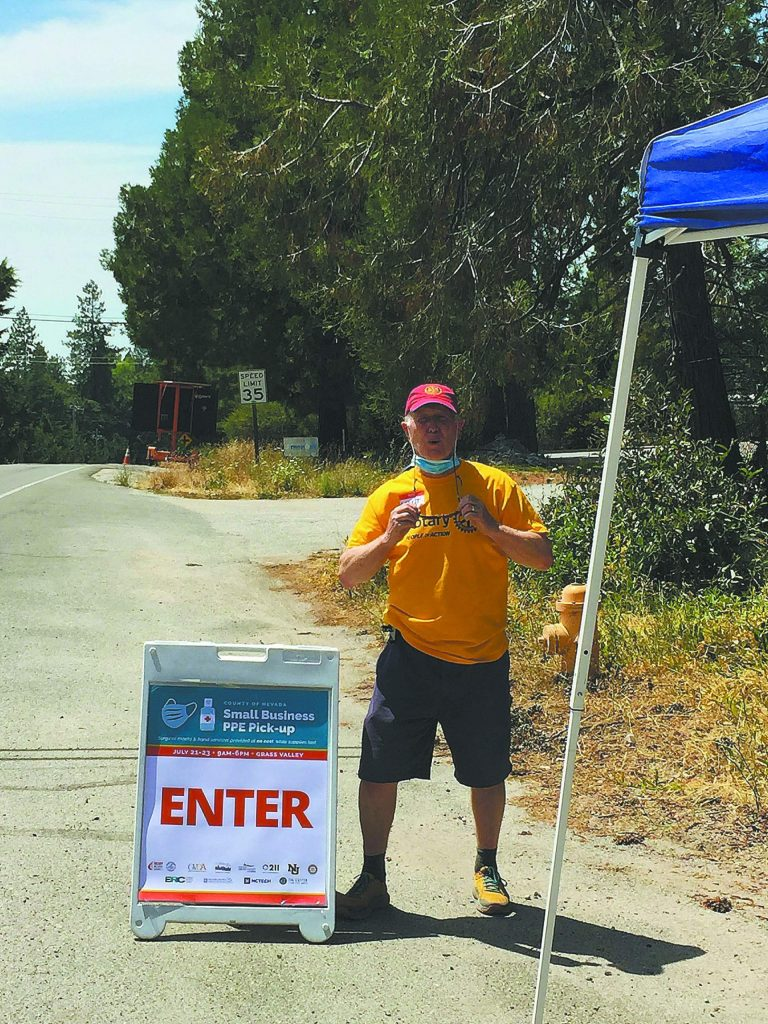 A Nevada City Rotarian participating in the county's PPE giveaway.