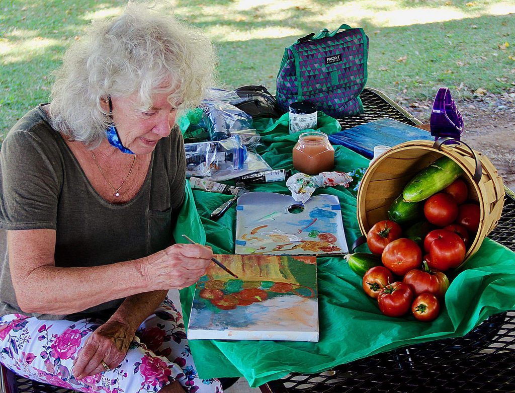 Artist Cheri Merrifield paints a still life of her homegrown tomatoes.