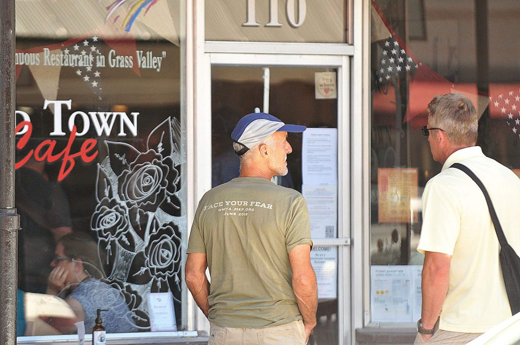 It was a busy day for customers and employees dining within downtown Grass Valley's Old Town Cafe, which has chosen to continue serving dine-in customers despite the governor's recent changes to the reopening plan.