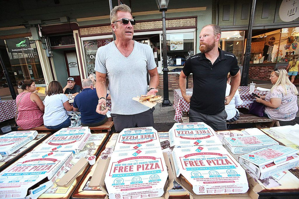 Free Nevada County organizer Eric Christen stands alongside Dylan Brooke and a table full of free pizza brought to Mill and Main streets where information regarding the Nevada County Boad of Supervisors plans to fine businesses and individuals who don't comply with the state coronavirus guidelines was being disseminated. According to the flyer, up to $10,000 per day and $500 for private citizens who do not comply with State coronavirus guidelines, is being considered by the Board of Supervisors during its Tuesday meeting..