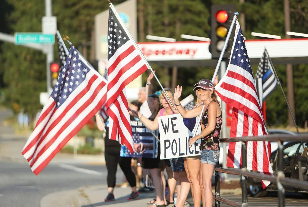 Red, white and blue flags were flown alongside black, white and blue flags and back the blue signs at the corner of Sutton Way and Brunswick Road Saturday. Peaceful protesters were out in force throughout the day with Back the Blue, Black Lives Matter, and Free Nevada County folks all showing their support for their cause at their respective locations.