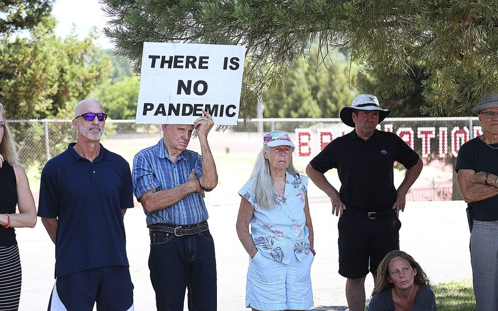 A man holds a sign stating that there is no pandemic during a Protect Nevada County Students press conference Thursday at Bear River High School.