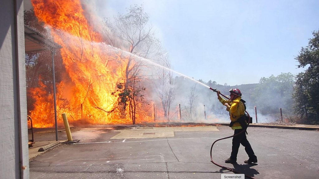 A Cal Fire firefighter makes an initial attack on a flare up of the Smartsville Fire in efforts to protect the Smartsville Post Office which was saved from a few attacks of the early July fire. A handful of outbuildings were lost in the fire that was kept to less than 10 acres.