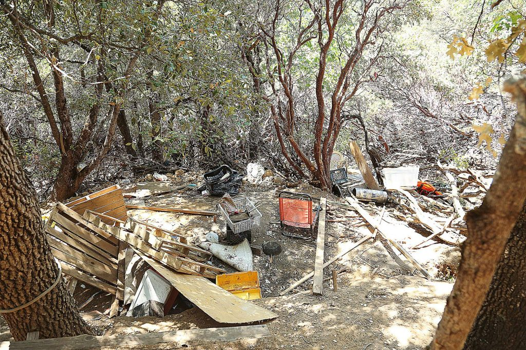 Evidence of homeless encampments can still be found among the brush of Sugarloaf Mountain outside of Nevada City following a recent cleanup.