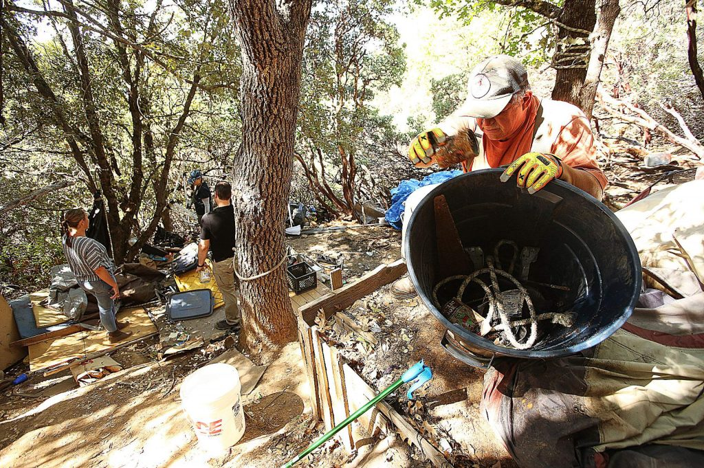 The Hospitality House Home Team and members of Nevada City Public Works joined in the cleanup of the Sugarloaf Mountain encampments Wednesday. The homeless residents of the camps have been temporarily relocated to the Northern Queen.