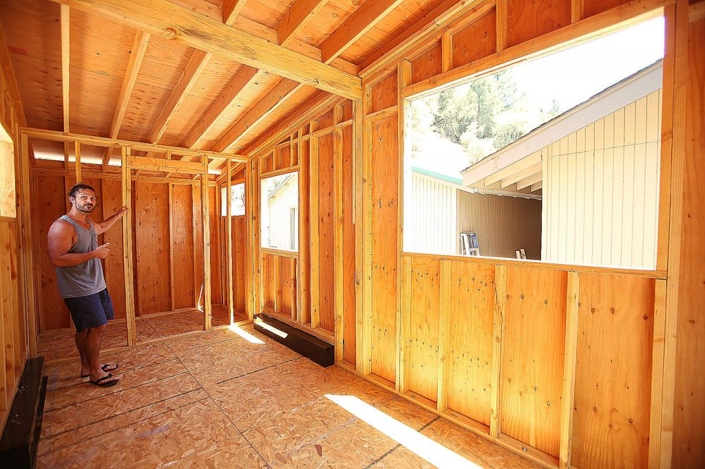 A large window on one side of the tiny home allows for natural light to enter the tiny home, like French doors.