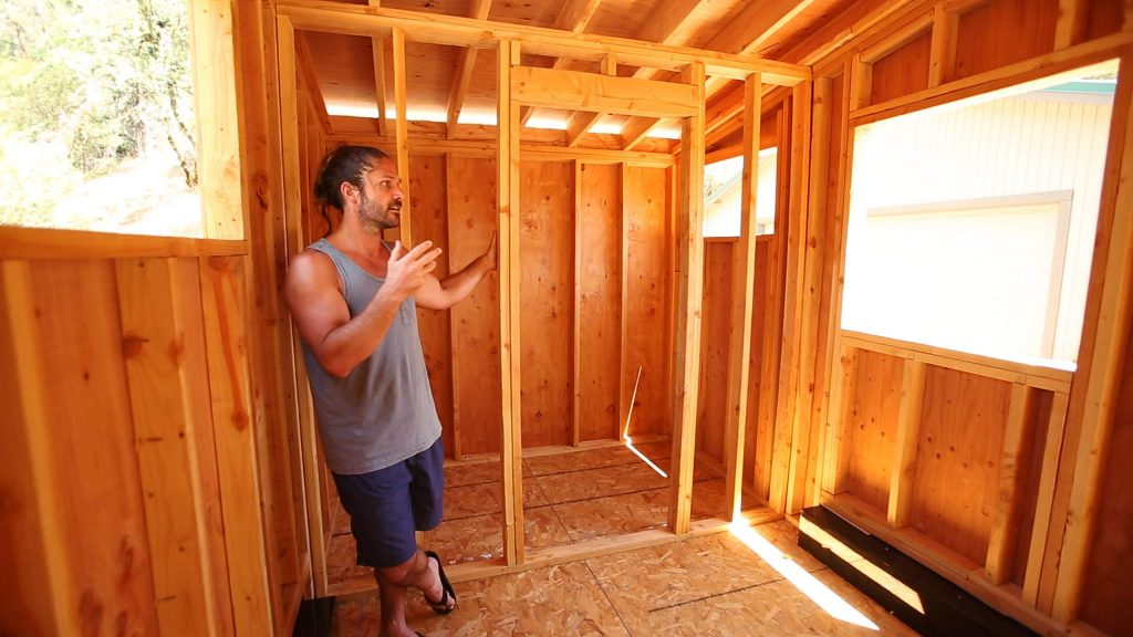 Mark Root shows off the interior of the tiny home he and his father Mark Root Sr. are constructing at their home in Colfax. Root stands in front of where the bathroom would be located.