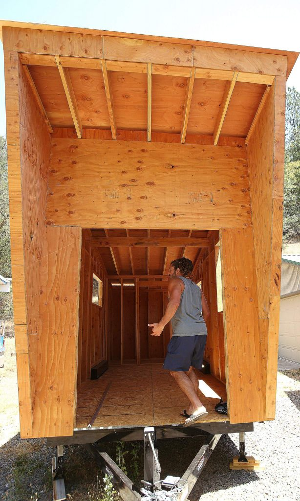 Mark Root walks through what would be the French door entry way of the tiny house he and his father Mark Root Sr. are building.