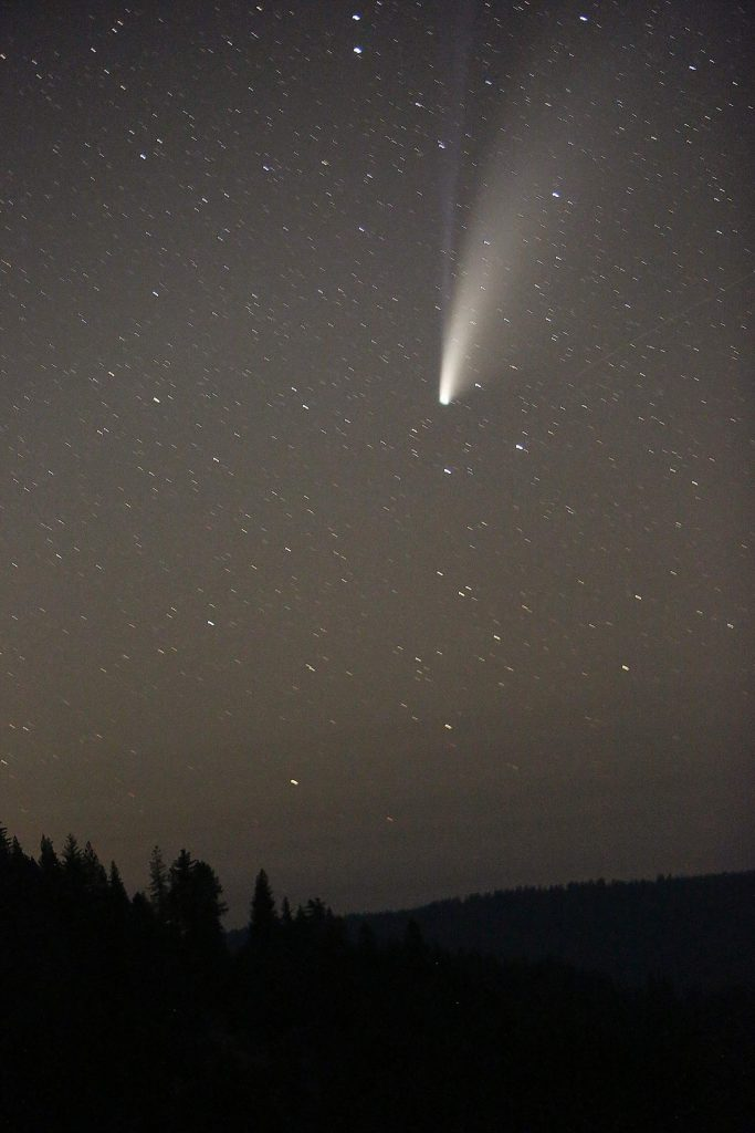Comet Neowise leaves its cosmic tails of dust and ionized gasses in the night sky as it makes its 6,766-year orbit of the sun as viewed from the Jefferson Creek Scenic Overlook off Highway 20 Saturday night. The comet will be closest to Earth on Thursday at 64 million miles away.