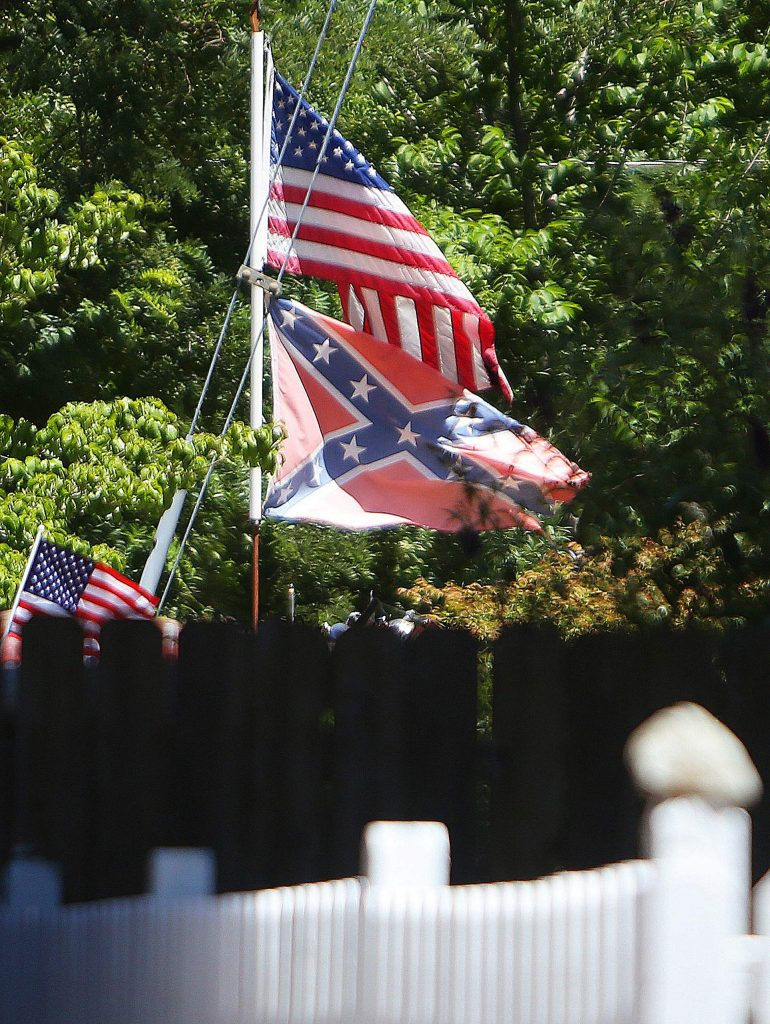 A Confederate flag is flown proudly from a front yard in the town of Washington, clearly visible from the town's main thoroughfare and businesses. Though other Nevada County communities have pushed back against the public display of the Confederate flag, others haven't.