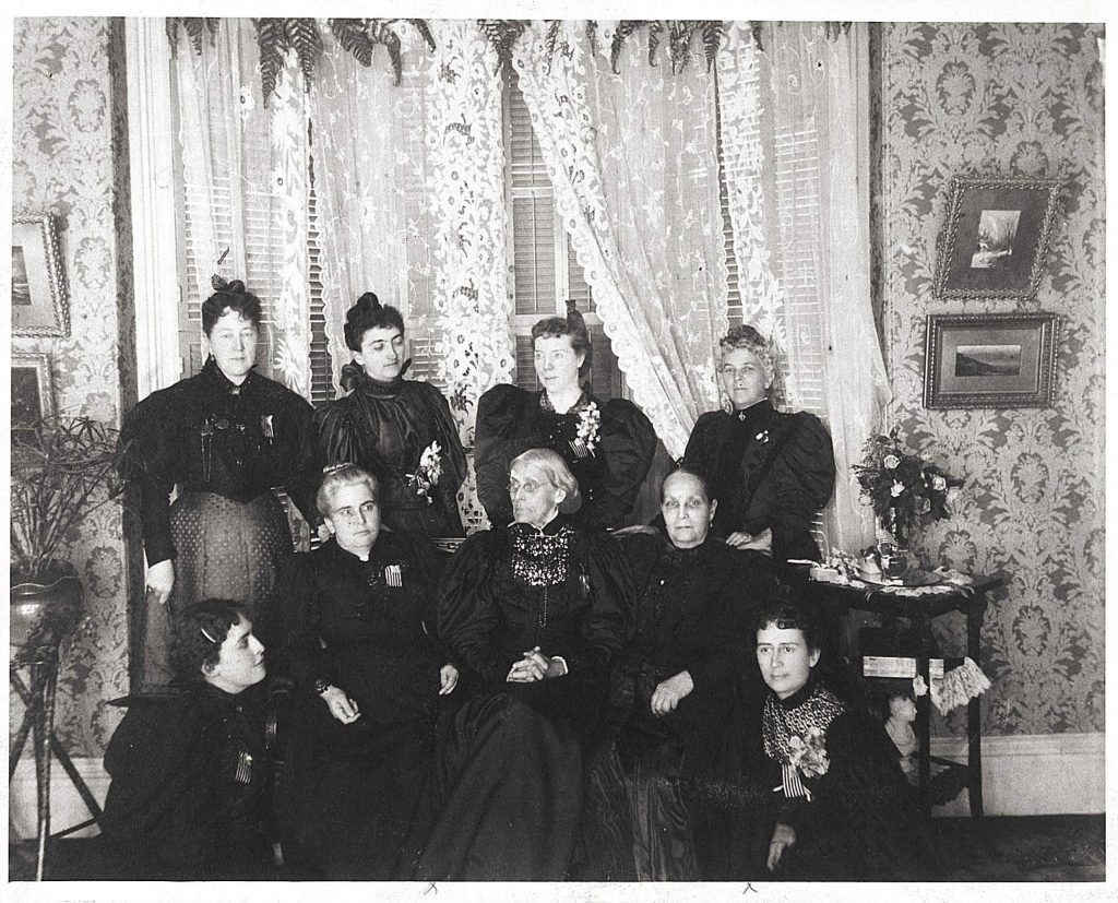 Suffragist leaders meet in 1896. From left, Ida Husted Harper, Selena Solomons, Carrie Chapman Catt, Anne Bidwell; seated, Lucy Anthony, Dr. Anna H. Shaw, Susan B. Anthony, Ellen Clark Sargent, and Mary Hay.