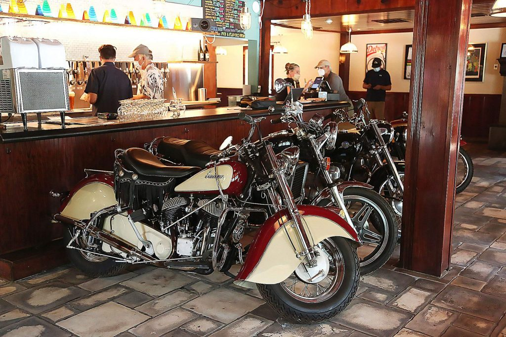 The new Wheelhouse, at the Old 5 Mile House along Highway 20, is open once again east of Nevada City with new owners and fresh servings. A collection of vintage motorcycles currently blocks the bar to aid in social distancing rules.