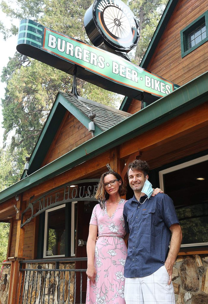 Wheelhouse co-owners Max Norskog and wife Amanda Norskog stand in front of the Old 5 Mile House and former ol' Republic Roadhouse.