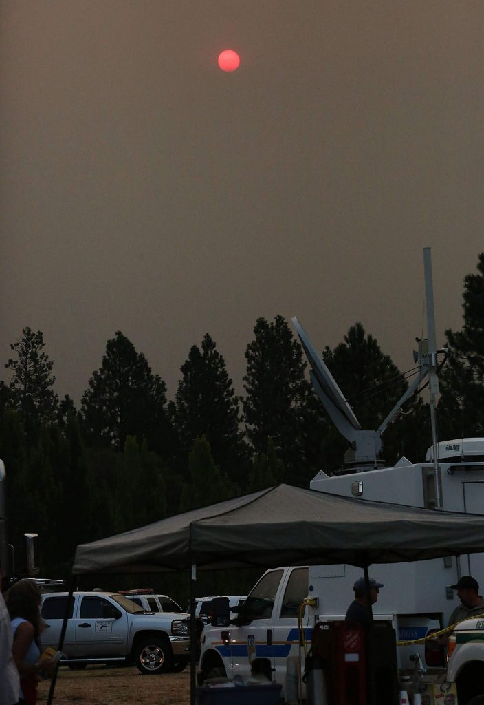 Smoke from the LNU Lightning Complex Fire burning near Lake County blocks the light of the sun Wednesday morning from the Jones Fire incident command center in Nevada City. Later, smoke from the Jones Fire smothered much of Grass Valley and Nevada City. Air quality was expected to get worse overnight, with it starting in the unhealthy range this morning.