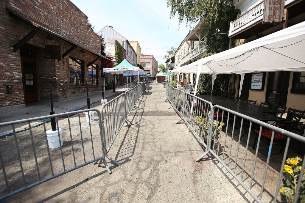 Outdoor dining tents and spaces fill Commercial Street in Nevada City to help businesses comply with social distancing efforts. The historic downtown street is between phases of construction, now slated to be completed next year.