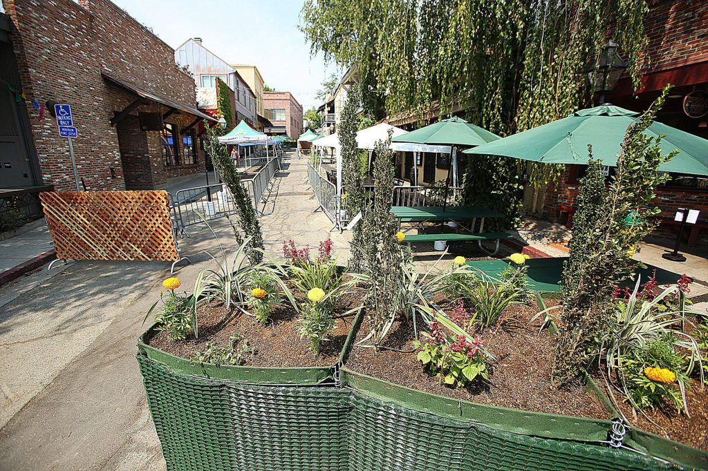 Large outdoor planter boxes have been placed at the ends of Commercial Street in downtown Nevada City, where construction on the rehab project has currently been stalled.