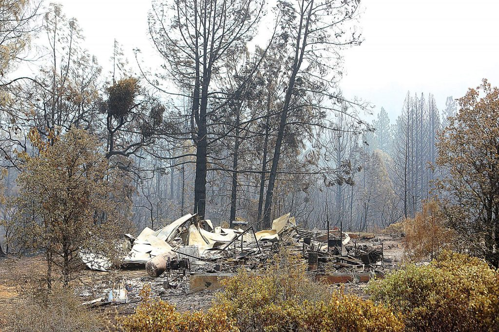 The Cooke's home sits in a pile of metal rubble and ash after the Jones Fire ripped through the Newtown region of Nevada County. A total of six homes and numerous outbuildings were destroyed.