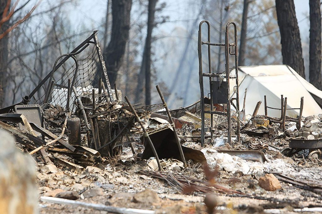 Only charred metal and ash remain where the Cooke's home once sat in the Newtown community of Nevada County.