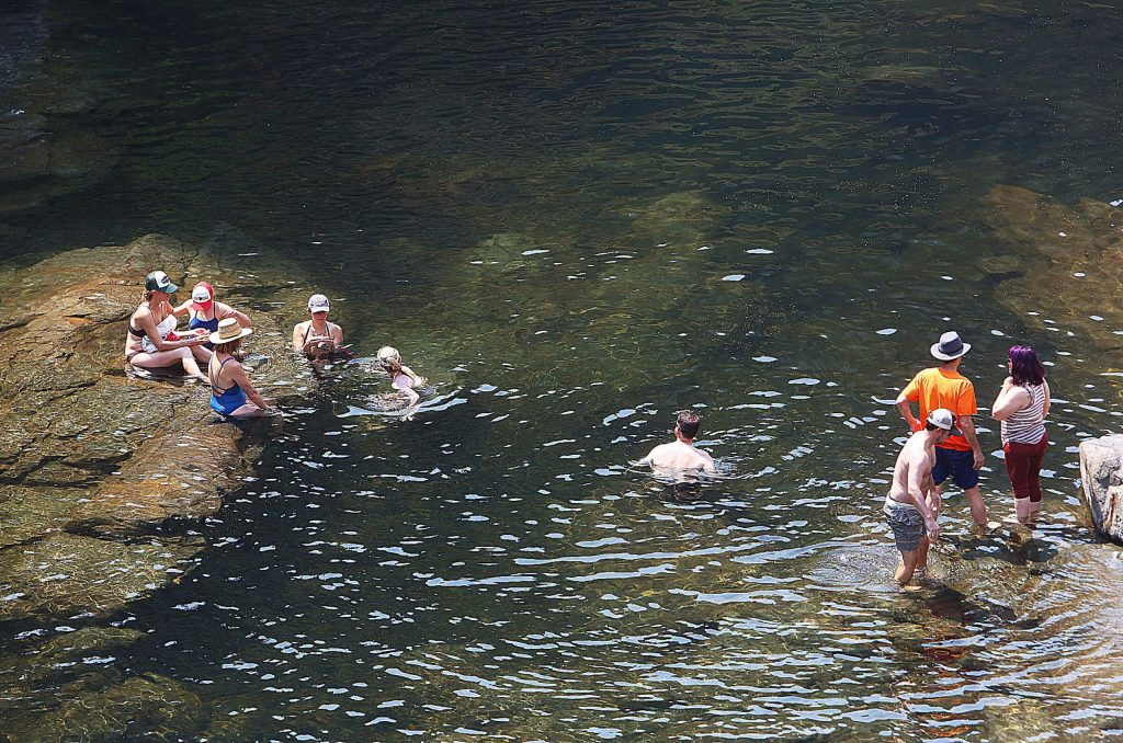 A group of people enjoy the waters of the South Yuba River at Edwards Crossing Saturday.
