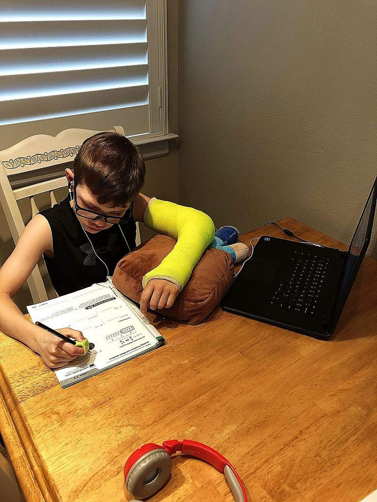 Tanner Van Metre of Seven Hills Middle School, distance learning with a broken arm.