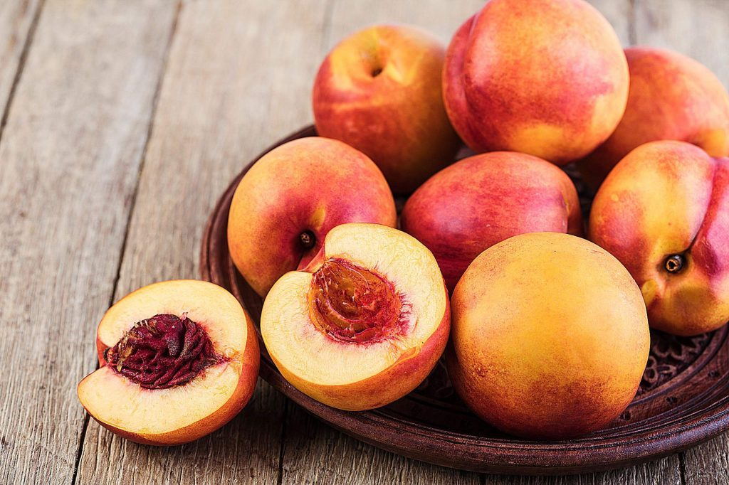The first of the really good peaches show up at our markets in June, and each week brings new varieties, peaking in late July and August. The season finally winds down in September, but can linger into early October in a good year.