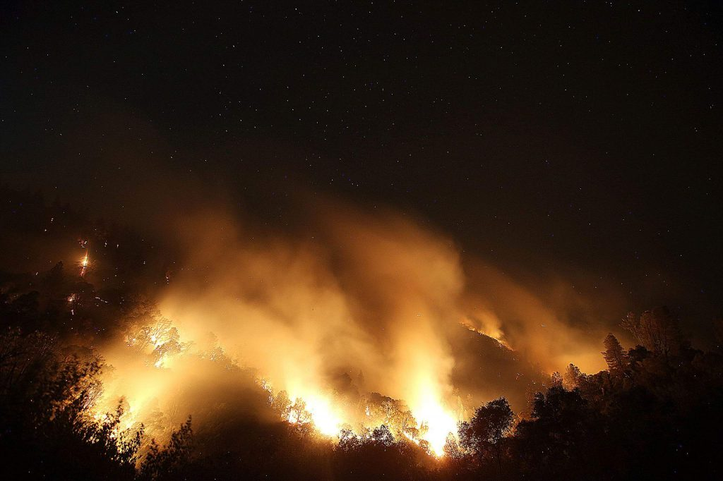 Smoke from the Jones Fire wafts as the fire smolders after burning nearly 500 acres on the first night of the fire.