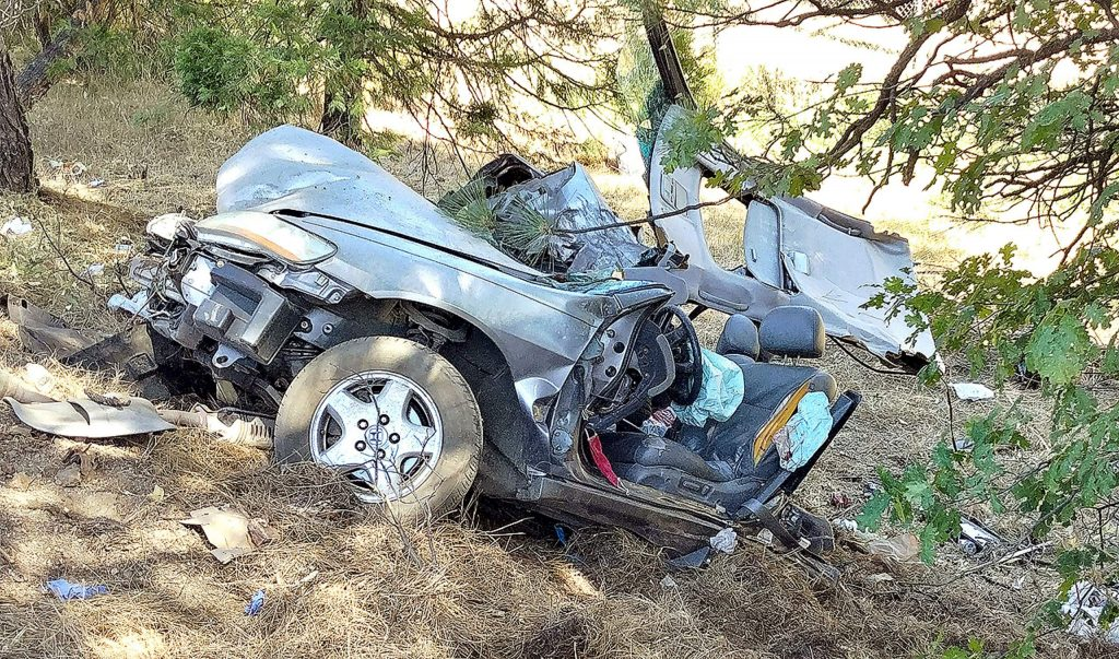 A solo-vehicle collision left a Honda cut in half at Highway 20 before the Gold Flat exit.