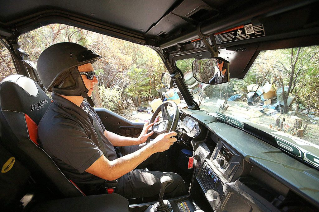Grass Valley Police Detective Dennis Grube drives the department's new UTV to assist in patroling homeless encampments.