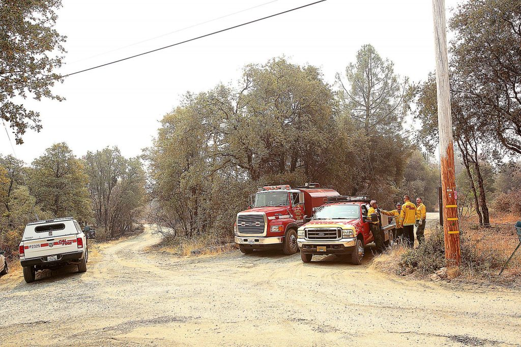 Firefighters continue to patrol the Tasha Road and surrounding areas for hotspots and flare ups of the Jones Fire Friday.