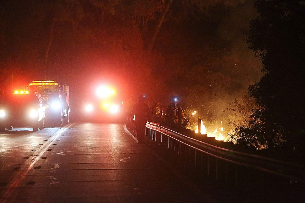 Cal Fire firefighters bump down Highway 49 while initiating the firing procedure early Tuesday morning.