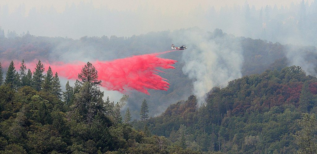 Cal Fire air tanker 88 drops a load of fire retardant before heading back to the Grass Valley Interagency Air Attack Base to reload. Both Grass Valley air tankers and others made a multitude of drops on the Jones Fire during day two of the incident Tuesday.