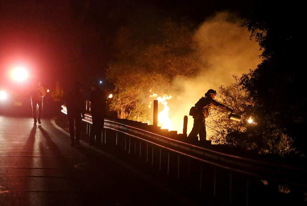 Cal Fire firefighters on Highway 49 while initiating the firing procedure early Tuesday morning.