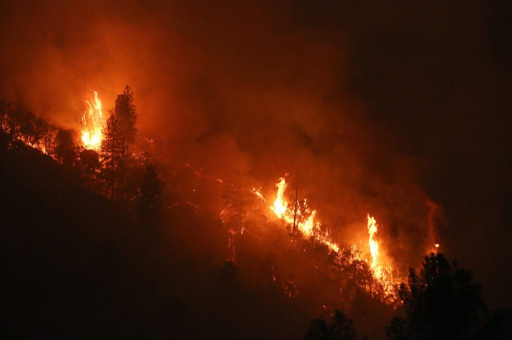 Vegetation smolders and trees are in flames throughout the night along the South Yuba River Canyon near Jones Bar, where the Jones Incident began Monday.
