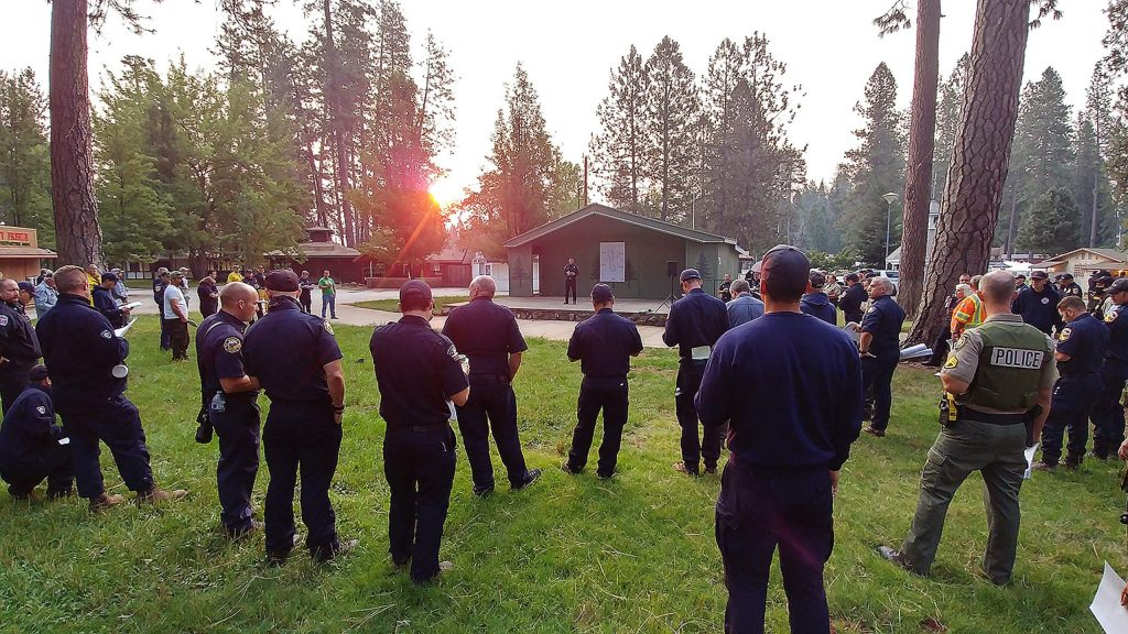 Firefighters and first responders gather for the morning briefing Thursday at the Nevada County Fairgrounds where the Jones Fire incident command center has been moved from the Rood Center to better accommodate the large number of personnel assigned to the incident.