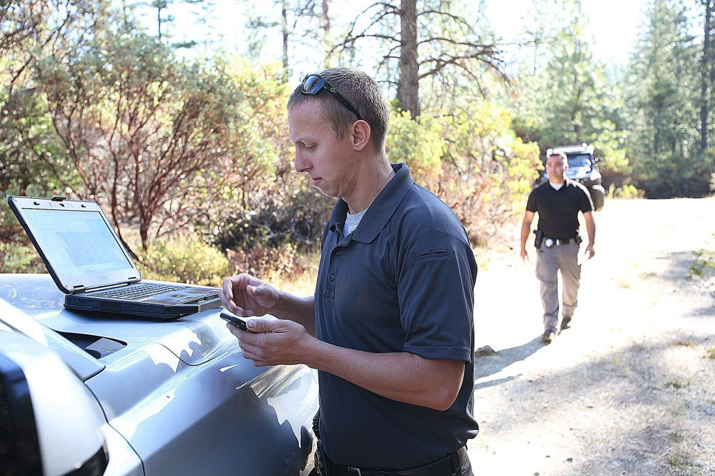 Detective Grube utilizes a laptop and cellphone maps that document active and vacant homeless encampments within the department's jurisdiction.