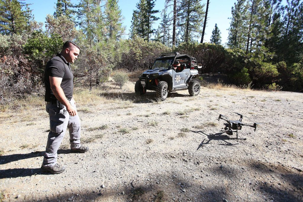 Grass Valley Police Detective Mel Bird fires up the department's drone used to help spot criminals from the sky. New equipment such as the drone and UTV help make homeless encampment law enforcement possible.