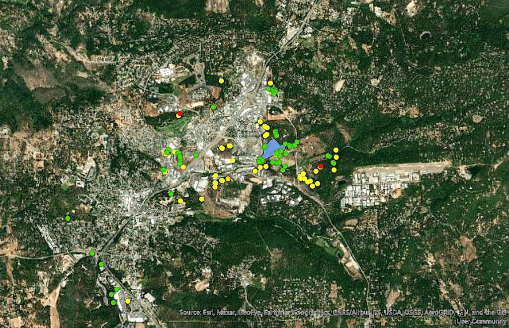 A map of the Glenwood Basin from 2019 shows current and former transient camps, as well as areas where there have been fires. Green dots show abandoned camps that have been cleaned up, while yellow and orange dots show abadoned camps that need to be cleaned up. Red dots show active camps.