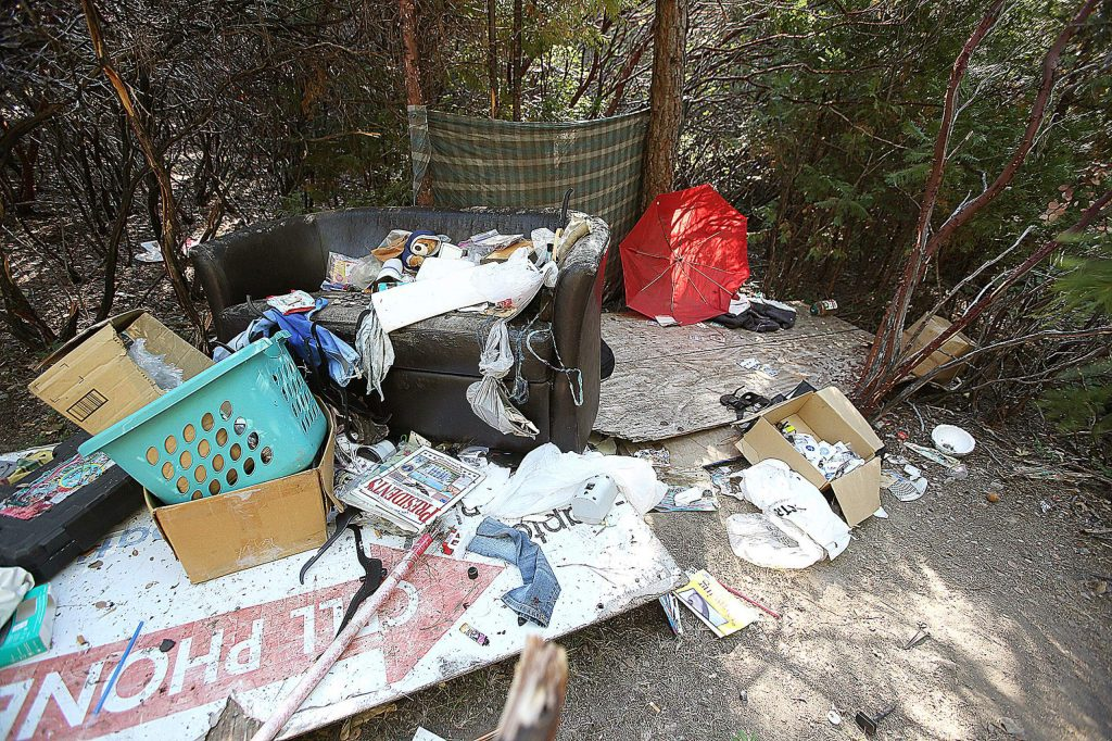Piles of trash left over from a camp vacated about three months ago sits in a portion of land near Idaho Maryland and Brunswick roads.
